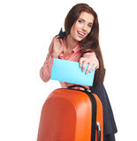 Woman with a suitcase and a ticket on a white background Stock Image