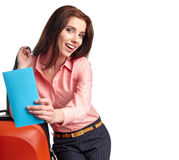 Woman with a suitcase and a ticket on a white background Royalty Free Stock Photography