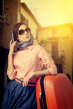 Woman with a suitcase travel  on street of italian city Stock Photos