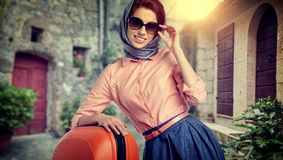 Woman with a suitcase travel  on street of italian city Royalty Free Stock Photos