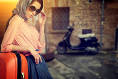 Woman with a suitcase travel  on street of italian city Royalty Free Stock Photography