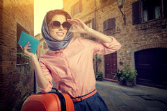 Woman with a suitcase travel  on street of italian city Stock Images