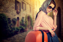 Woman with a suitcase travel  on street of italian city Royalty Free Stock Photo