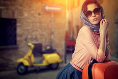 Woman with a suitcase travel  on street of italian city Royalty Free Stock Image