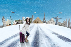 Woman with suitcase and the world landmarks Stock Photos