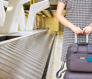 Woman with suitcases Stock Images