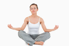 Woman in the Sukhasana position Royalty Free Stock Photography