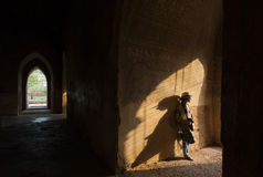 Woman in Sulamani Pagoda, Bagan, Myanmar. Illuminated by sunset Royalty Free Stock Image