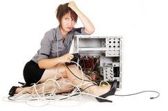 Woman sulking with computer Stock Images