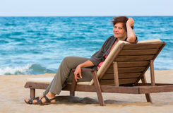 Woman on summer beach. Royalty Free Stock Images
