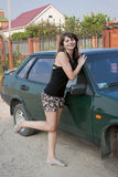 woman in summer is about the car Stock Photo