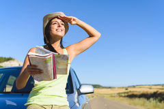 Woman on summer car travel vacation. Happy woman enjoying freedom on summer car travel vacation in spain. Female traveler with road map on roadtrip Royalty Free Stock Images