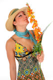 Woman summer clothing flower. Attractive young  woman with casual summer clothing holding flower.  Studio shot, white background Stock Photos