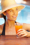 Woman in summer with cocktail Royalty Free Stock Image