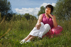 Woman in summer day rest in the open air Stock Photography