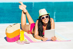 Woman on summer with digital tablet Stock Image