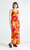 Woman in summer dress. Full height portrait of a middle aged woman in colorful orange dress Royalty Free Stock Images
