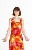 Woman in summer dress. Full height portrait of a middle aged woman in colorful orange dress Stock Images