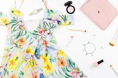 Woman summer dress, accessories and make up items on white background. Summer fashion collection Royalty Free Stock Photography