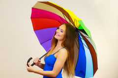 Woman in summer dress holds colorful umbrella Royalty Free Stock Photo