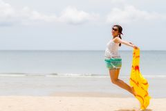 Woman in summer dress jumping over sand Royalty Free Stock Photo