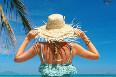 Woman in summer dress and straw hat on beach looking beatiful se Stock Photography