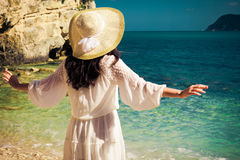 Woman in summer dress with  straw hat Royalty Free Stock Photography