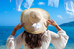 Woman in summer dress with  straw hat Stock Image
