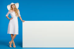 Woman In Summer Dress, Sun Hat And High Heels Is Posing With White Banner Stock Photography