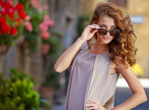 Woman in summer dress walking and running joyful and c Stock Photography