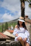 Woman in summer dress walking and running joyful and cheerful smiling in Tuscany, Italy royalty free stock image