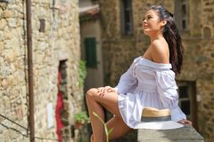 Woman in summer dress walking and running joyful and cheerful smiling in Tuscany, Italy stock photography