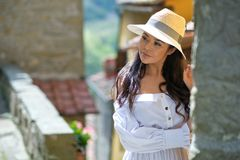 Woman in summer dress walking and running joyful and cheerful smiling in Tuscany, Italy royalty free stock images
