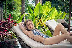 Woman Summer Fashion. Happy Sexy Girl With Fit Body, Long Legs, Healthy Skin In Bikini, Sunbathing By Swimming Pool On. Travel Holidays Vacation. Beauty Stock Image