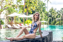 Woman Summer Fashion. Happy Sexy Girl With Fit Body, Long Legs, Healthy Skin In Bikini, Sunbathing By Swimming Pool On Royalty Free Stock Photos