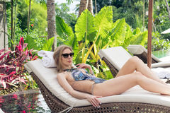 Woman Summer Fashion. Happy Sexy Girl With Fit Body, Long Legs, Healthy Skin In Bikini, Sunbathing By Swimming Pool On. Travel Holidays Vacation. Beauty Royalty Free Stock Photo