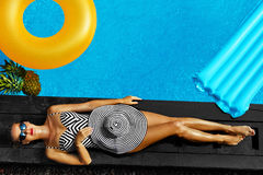 Woman Summer Fashion. Sexy Girl Sunbathing By Swimming Pool. Beauty. Woman Summer Fashion. Happy Sexy Smiling Girl With Fit Body, Long Legs, Healthy Skin In Stock Photography
