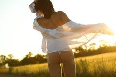 Woman on summer field Stock Photo