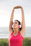 Woman on summer fitness workout stretching arms Royalty Free Stock Images