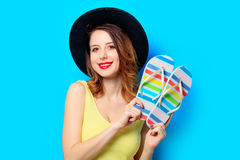 Woman with summer flip-flops Stock Images