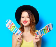 Woman with summer flip-flops Royalty Free Stock Photo