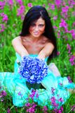 Woman on summer flower field Stock Photos