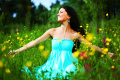 Woman on summer flower field Stock Photography