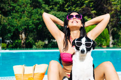 Woman on summer funny vacation with dog Stock Photography