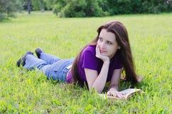 Woman in a summer garden Stock Photos