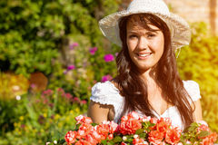 Woman in summer garden with flowers Royalty Free Stock Image