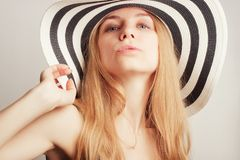 Woman  in a summer hat Stock Photo