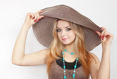 Woman in summer hat. Beautiful young woman in the summer hat Stock Photo