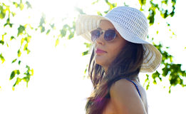 Woman in summer hat Stock Photos
