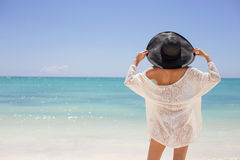 Woman in summer hat on the beach Royalty Free Stock Photos